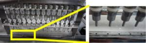 Primer plano de detalle del tubo del carro de limpieza y sus orificios de inyección
