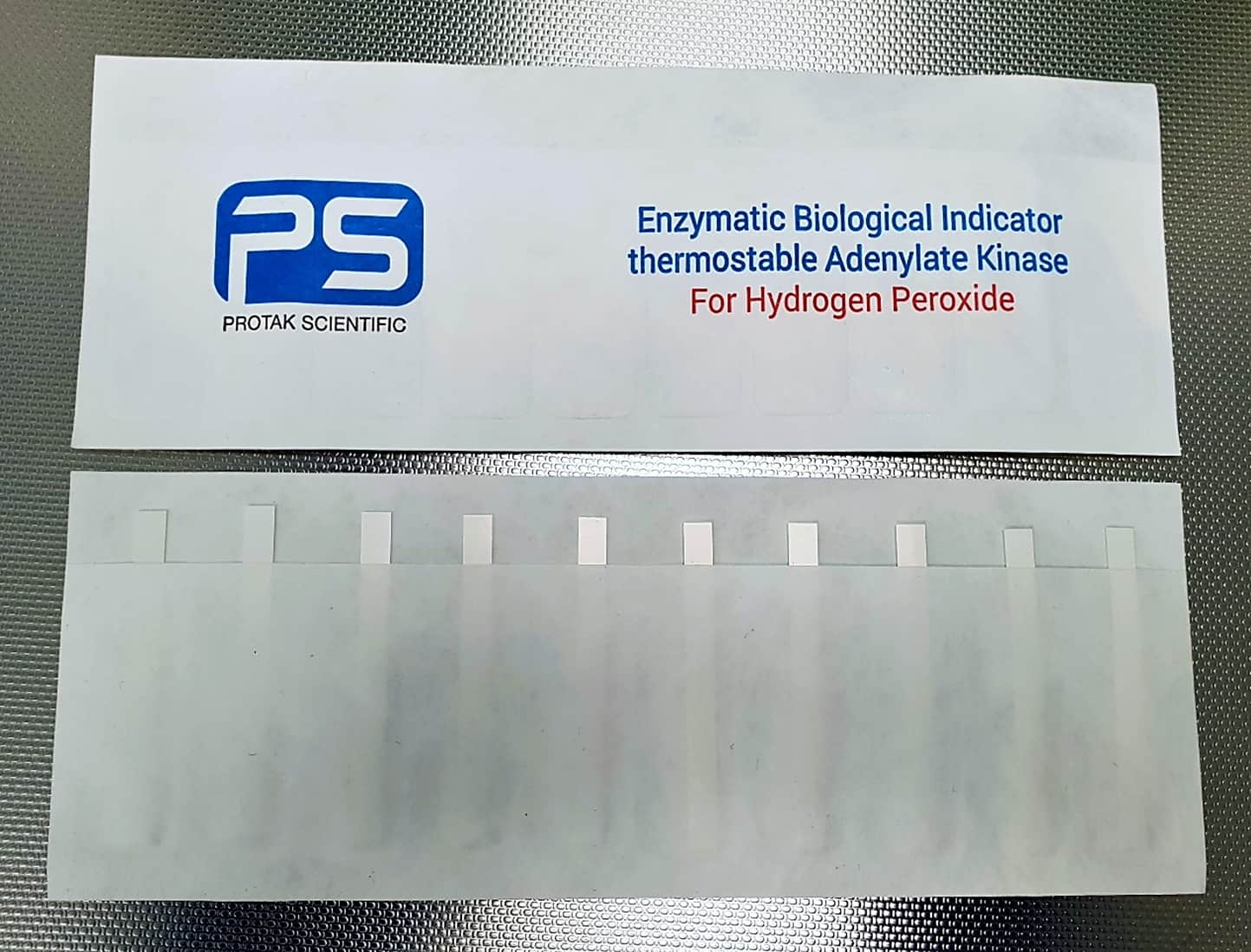 Enzyme indicator strips for validation of hydrogen peroxide biodecontamination cycles